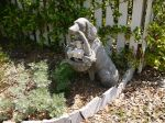 Dog statue at Dutton-Waller cottage
