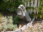 Dog statue at Dutton-Waller cottage